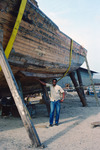 Man with Wooden Boat