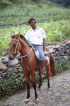 Unidentified Man Riding a Horse