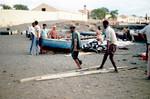 Two Men Hauling Tuna onto Shore