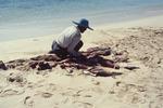 Kneeling Fisherman Among his Catch