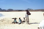 Fisherman and Children on Beach
