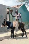 Man on Donkey, Smoking