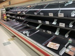 Empty area of local grocery store by Devin Costa