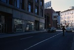 Downtown Pawtucket Main St. with empty store and redevelopment agency in picture